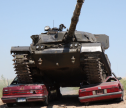 drive a real army tank with a double car, trailer crush, shoot 10 guns ranging from WWI to today